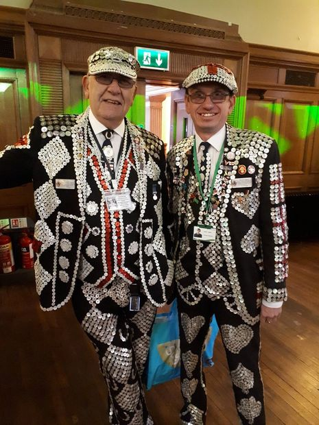 Father and son at Islington pensioners Christmas party 2019