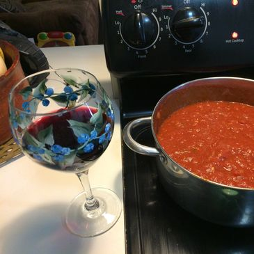 Homemade sauce that cooks all day, great for dinner, easy meal, glass of red wine, recipe, food blog