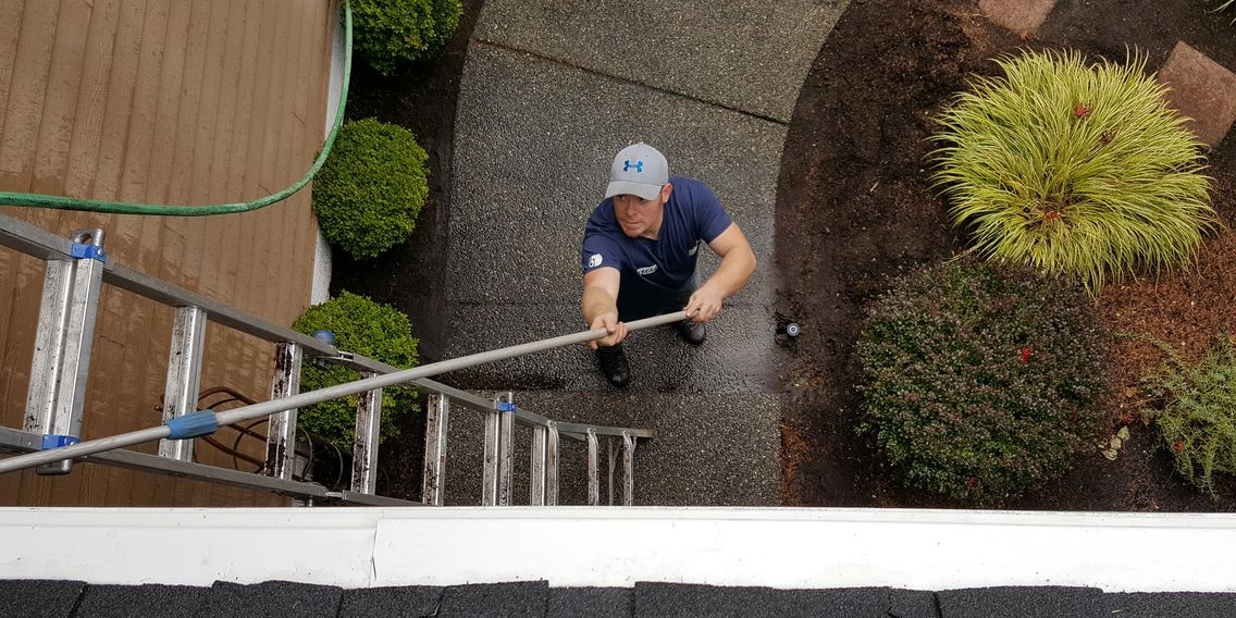 gutter cleaning maintenance service for a residential client