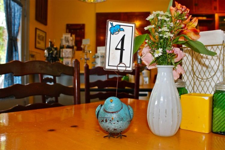 Table with bluebird table marker sitting inside Bluebird Bakery and Cafe.