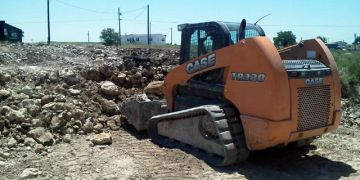Dit work and excavation for a retaining wall in Justin, Texas.