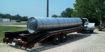JNB delivering a tin horn corrugated steel culvert pipe in Tioga, Texas.