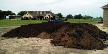 Topsoil and common fill dirt delivered to Krum, Texas by JNB Grading & Gravel.