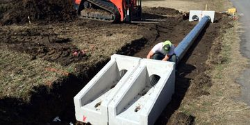 Precast concrete sloped safety ends and double culvert pipe installation in Aubrey, Texas.