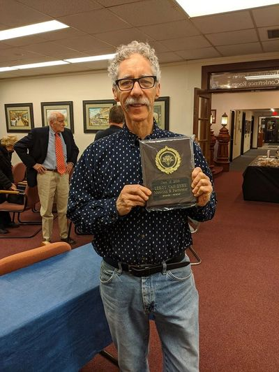 Dan Smith holding the award for Leroy Van Dyke at the St. Joseph Museums on November 30, 2019