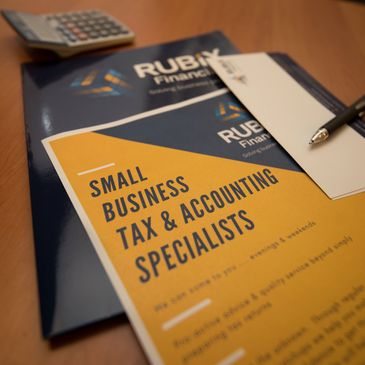 Small Business Tax & Accounting Specialists brochure on a table