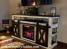 Sliding or hinged barn door cabinet with fireplace insert.