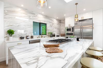 Calacatta Gold Marble Porcelain Slab Kitchen with island and waterfall in Los Angeles