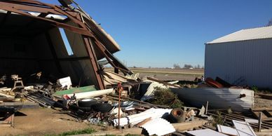 image of a steel pole barn damaged by straight line winds