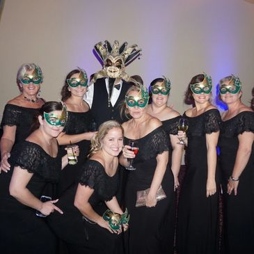 group of women at a mascarade party