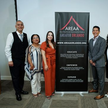 4 people standing posing at asian american event