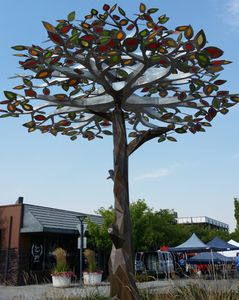 Metal sculpture tree with red, yellow and green leaves