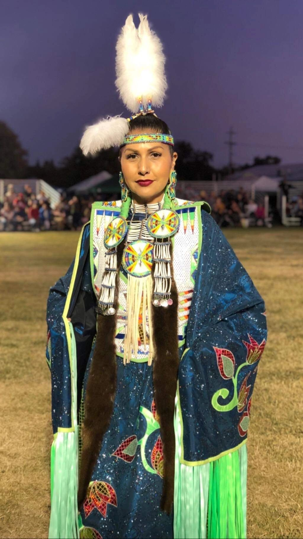 Native American woman in traditional cultural clothing
