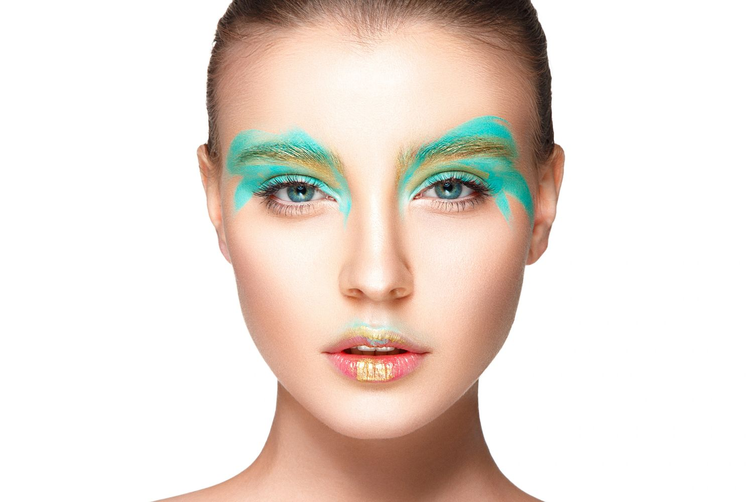 Beautiful woman with teal eye shadow and gold flecked lip