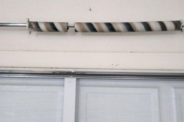 A broken spring in Phoenix, AZ, that needs repair from a garage door company