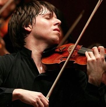 A sweaty man, dark haired and mid-30s, passionately plays the violin.