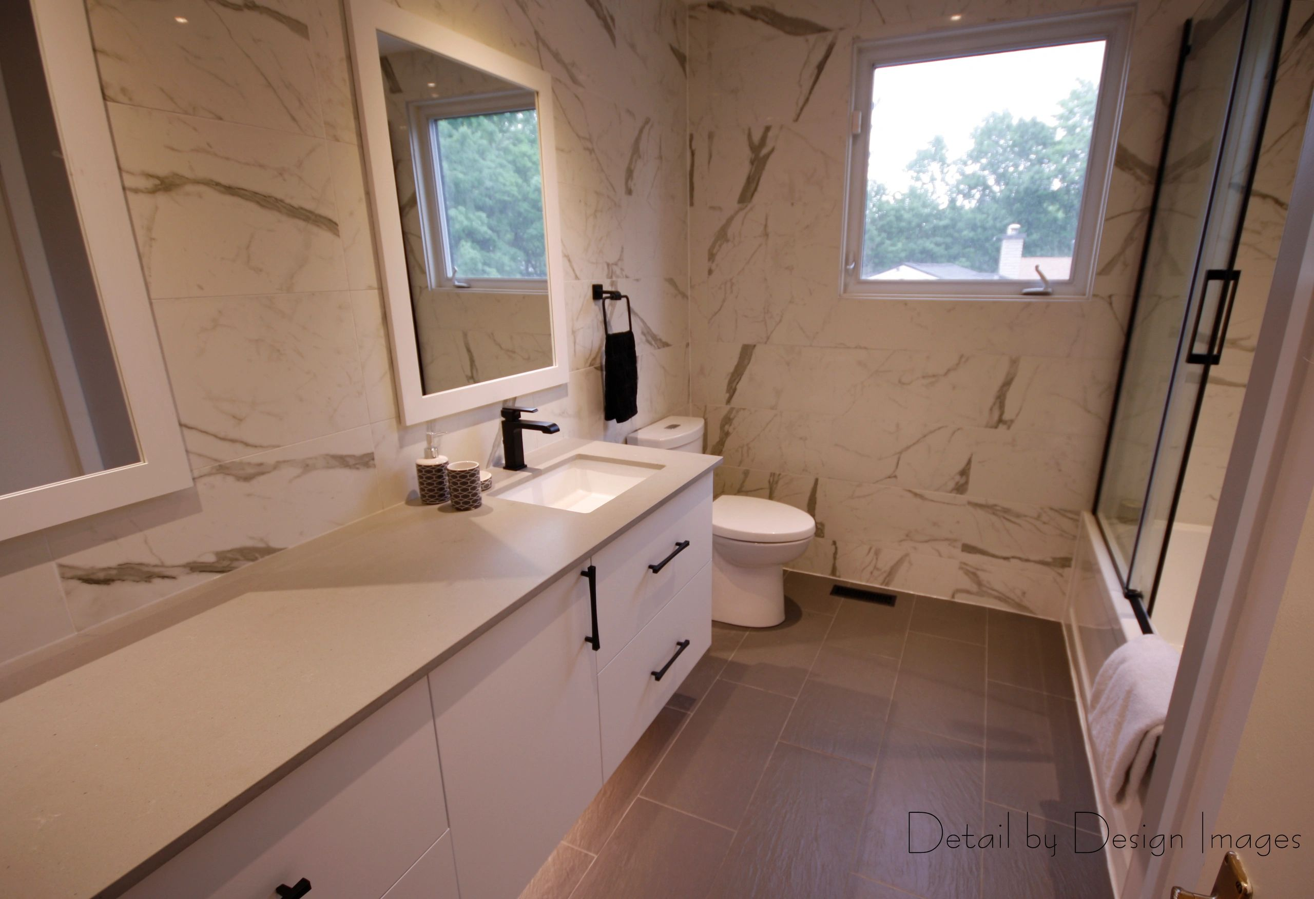 Bathroom renovation, marble-look tile, custom cabinetry, bathtub shower, transitional/contemporary d