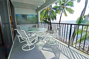 Relasx on your Private lanai in this vacation rental by owner. Watch surfers at Banyans Beach.