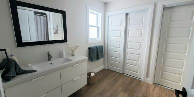 master bathroom with double closets