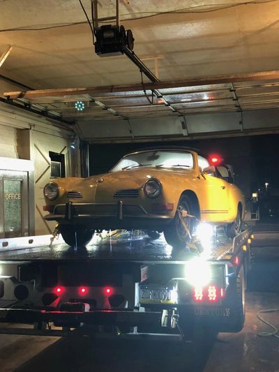 Karman Ghia on the rollback Bed of Kelly Towing in Scranton Pa