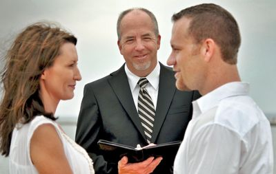 Tom Hamel of My West Michigan Wedding performing a marriage ceremony