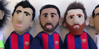 Three Barcelona Football player glove puppets.