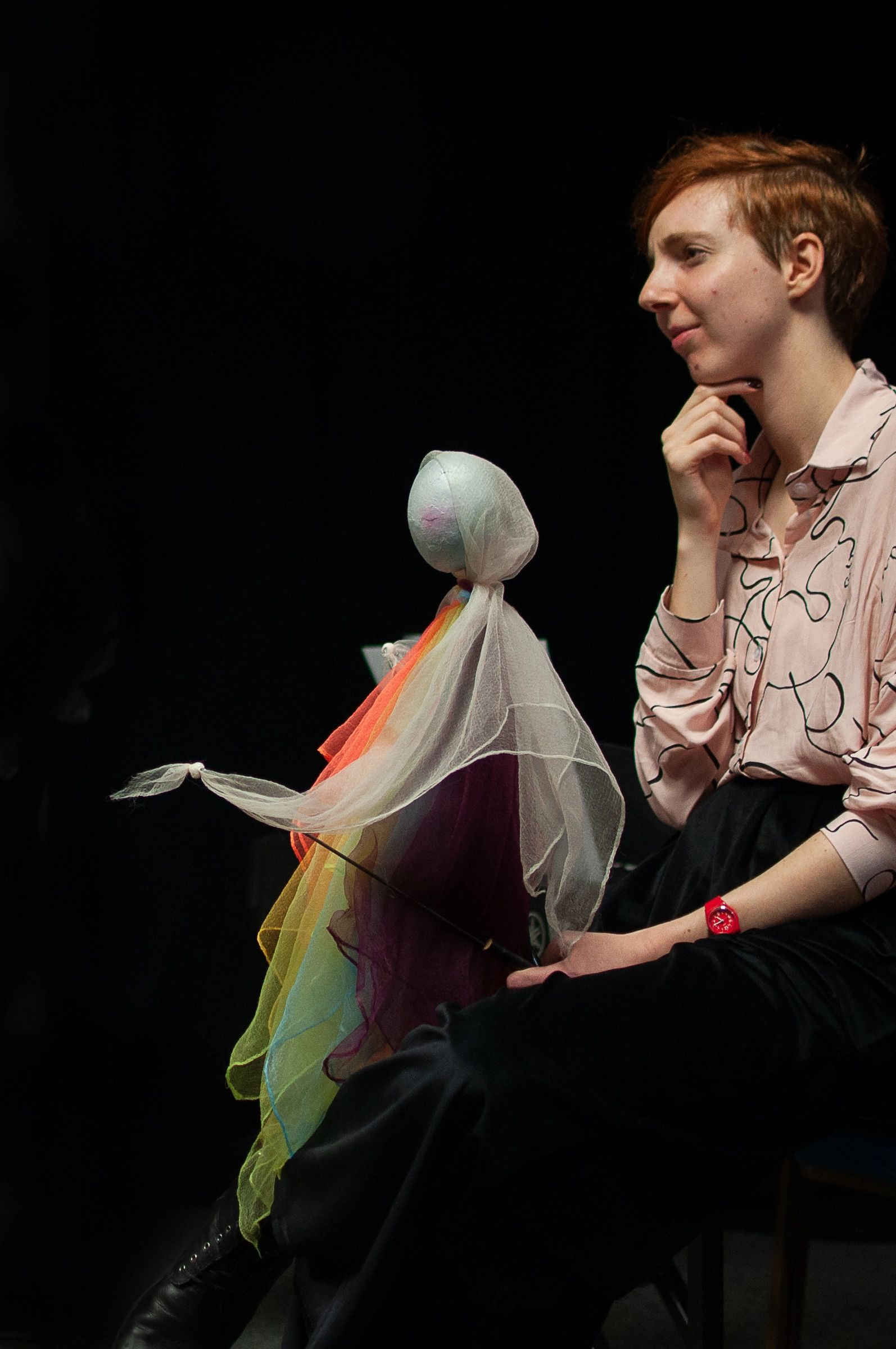 Alicia Britt, holding a puppet designed and made for Busy Being Ze by Loaded Object Theatre