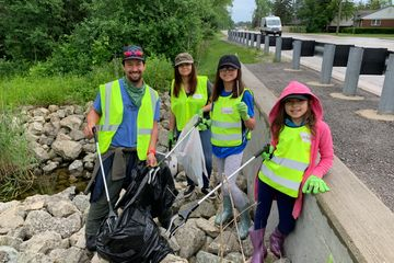 Family volunteers with Clean Up - Give Back