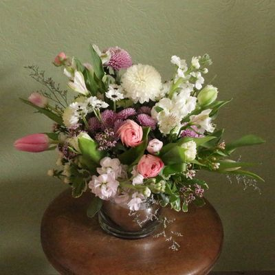 """Spring anytime"" table arrangement in pastel pinks and white."