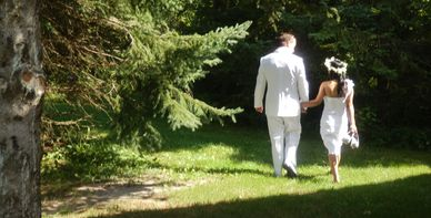 2012 photo of couple walking under trees at Nestleton Waters Inn