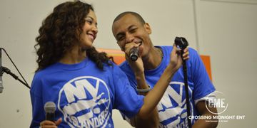 Crossing Midnight Entertainment talent sings for NY Islanders.