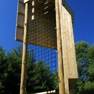 Military Climbing Tower with cargo net climb, bead climb, rappel face and giant ladder.