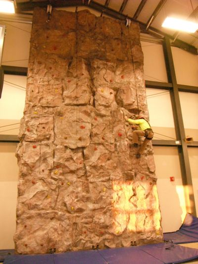 Indoor natural rock climbing wall at a university in Illinois.