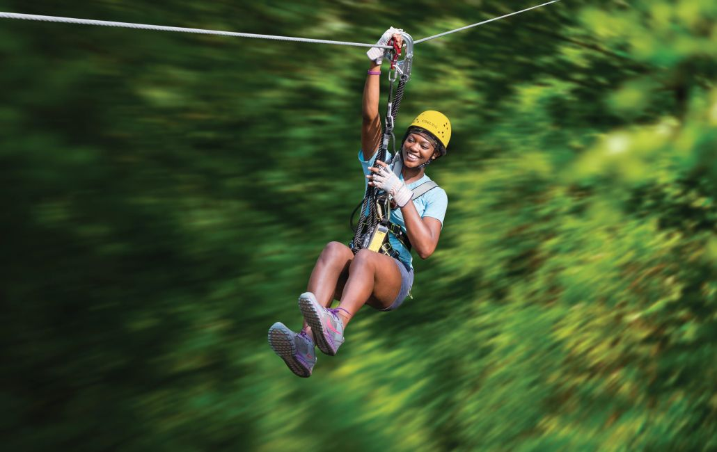 Zip-line participant at aerial adventure park in Ohio.