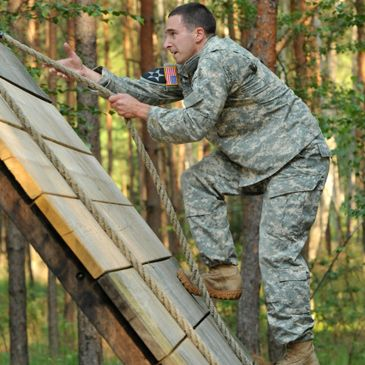 Soldier on military confidence course.