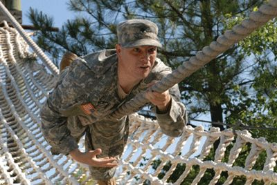 Soldier participating in military training program obstacle course.