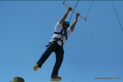 Ropes course participant on Pamper Leap activity at an adventure course in Missouri.
