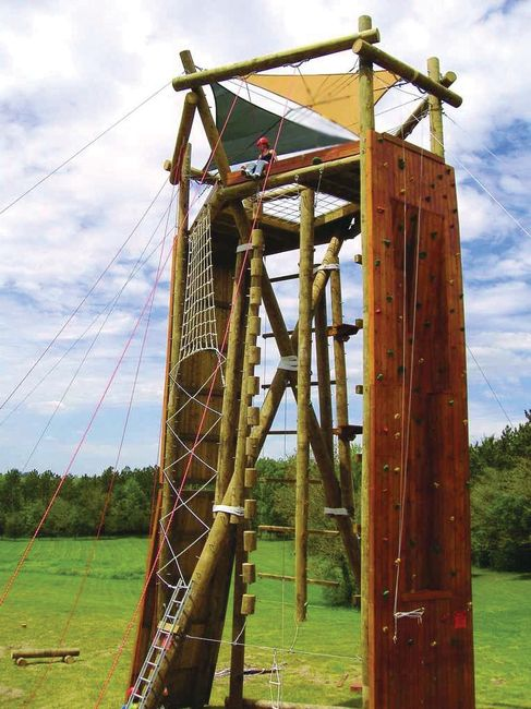 Tango tower in Texas with climbing wall face, cargo net climb, bead climb, and giant ladder.