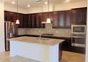 Open Kitchen to living space, Granite, Stainless Steel gas Appliances.