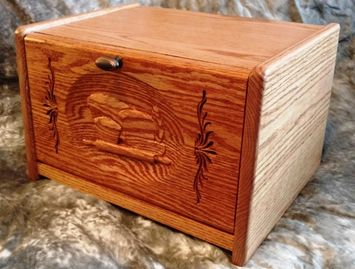 Solid Oad carve front bread box.