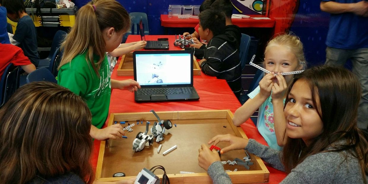 students learning robotics at school