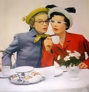 Color images of two 1940's women gossiping at tea