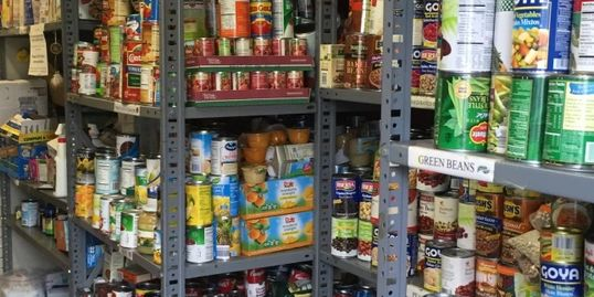 Cans of food on pantry shelves