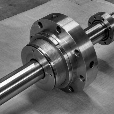 A custom precision machined shaft made in our Nacogdoches, TX production facility