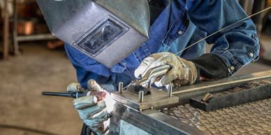 Welding a custom part at Turner Fabrication machining and welding facility in Nacogdoches, TX