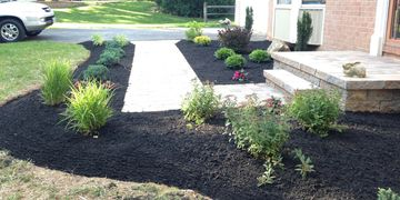 Mulch delivery and installation including weeding and edging beds. Spring Cleanup and landscaping.
