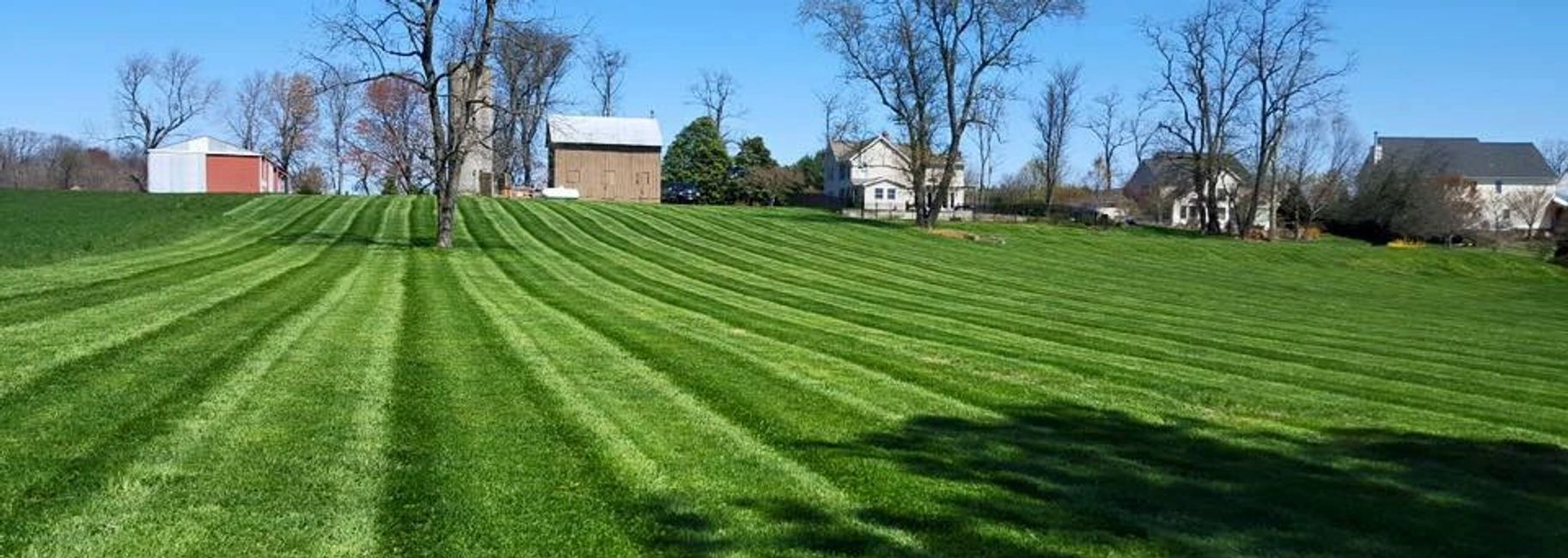 Sykesville MD lawn with green stripes. Best lawn care company in Maryland | LaneScapes Lawn Care