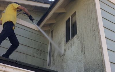 Power washing some very dirty stucco!