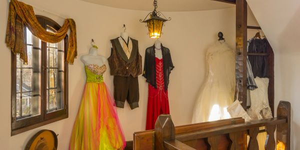 Costumes hanging on the wall.