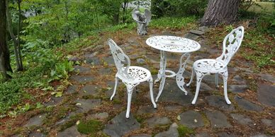 White wrought iron table and two chairs.